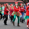"Preformers from the Alcott Drama team spoofs the Internet sensation dance ""Gangnam Style"" during the Norman Christmas Parade on Saturday. Julie Bragg/ For the Transcript"