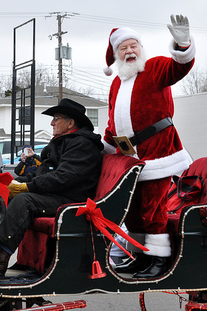 Santa Claus pays a visit during the Norman Christmas Parade on Saturday. Julie Bragg/ For the Transcript
