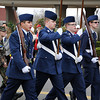 Boys and girls of the Civil Air Patrol march during the annual Norman Christmas Parade on Saturday. Julie Bragg/ For the Transcript