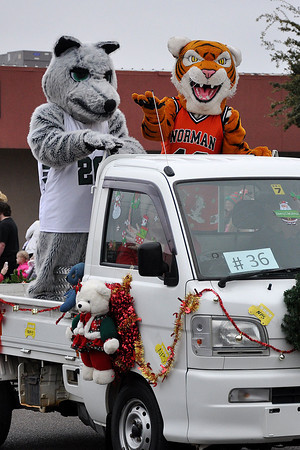 Norman High and Norman North High School mascots take part in the annual Norman Christmas Parade on Saturday. Julie Bragg/ For the Transcript