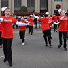 Members of the Sooner Theater program sing and dance during the Norman Christmas Parade on Saturday. Julie Bragg/ For the Transcript