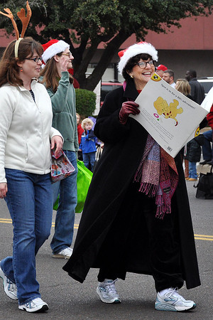 Members of Norman Library walk and read in the Norman Christmas Parade on Saturday. Julie Bragg/ For the Transcript