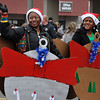 """Christmas balls"" march with Johnson Controls during the Norman Christmas Parade. Julie Bragg/ For the Transcript"