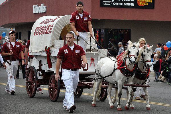University of Oklahoma Sooner Schooner takes part in the annual Norman Christmas Parade on Saturday morning. Julie Bragg/ For the Transcript