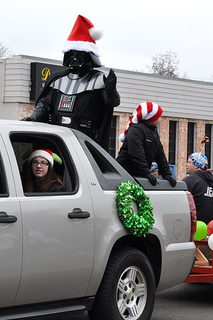 Darth Vader helps in support of the Jedi OKC program during the Norman Christmas Parade on Saturday. Julie Bragg/ The Transcript