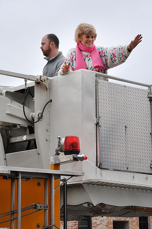 City of Norman's Mayor Cindy Rosenthal wave at parade goer's during the Norman Christmas Parade on Saturday. Julie Bragg/ For the Transcript
