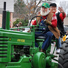 Members of the Candian Rivers Old Iron Club drive tractors during the Norman Christmas Parade on Saturday. Julie Bragg/ For the Transcript