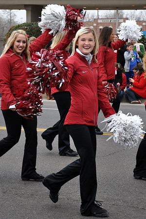 University of Oklahoma Cheerleaders march in the Norman Christmas Parade on Saturday morning. Julie Bragg/ For the Transcript