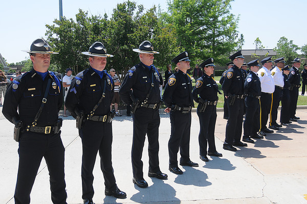 during the 2012 Law Enforcement Memorial Service at the fallen officer memorial in front of the Norman Police Department. Photo by Jerry LaizureFriday, May 18, 2012, during the 2012 Law Enforcement Memorial Service at the fallen officer memorial in front of the Norman Police Department. Photo by Jerry Laizure