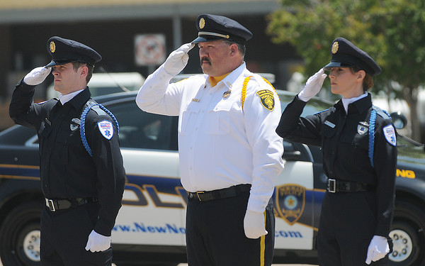 Friday, May 18, 2012, during the 2012 Law Enforcement Memorial Service at the fallen officer memorial in front of the Norman Police Department. Photo by Jerry Laizure