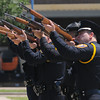 An honor guard of local police officers fire a 21-gun saluteFriday, May 18, 2012, during the 2012 Law Enforcement Memorial Service at the fallen officer memorial in front of the Norman Police Department. Photo by Jerry Laizure