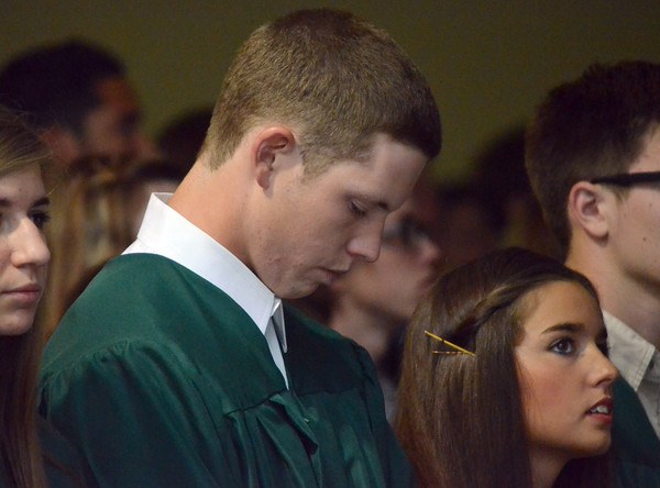 Cody Lawson boes his head in prayer during the  2012 Senior Baccalaureate for Norman High and Norman North Sunday evening at McFarlin Memorial United Methodist Church.<br /> Kyle Phillips/The Transcript