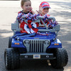 Henry Cody drives his friend Presley Boyd in the Vineyard neighborhood 4th of July parade. Jerry Laizure / The Transcript