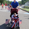 Scott Hough pushes son Mason  in the Vineyard neighborhood 4th of July parade. Jerry Laizure / The Transcript