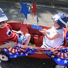 Jac and Ella Short catch a ride in the Vineyard neighborhood 4th of July parade. Jerry Laizure / The Transcript