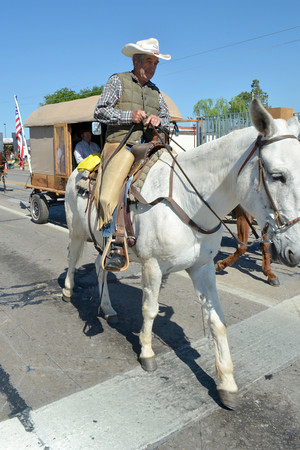 A rider tries to keep his horse under control as he participates in the '89er Day Parade Saturday morning.  The parade went down Main Street and ended at Crawford Avenue.<br /> Transcript Photo by Kyle Phillips