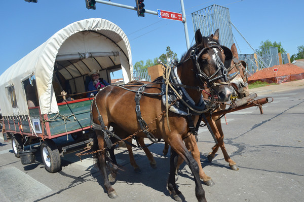 A wagon makes its way down Main Street Saturday morning during the 89er Day Parade.  The parade started at Norman High School and ended at Main Street and Crawford Avenue.<br /> Transcript Photo by Kyle Phillips