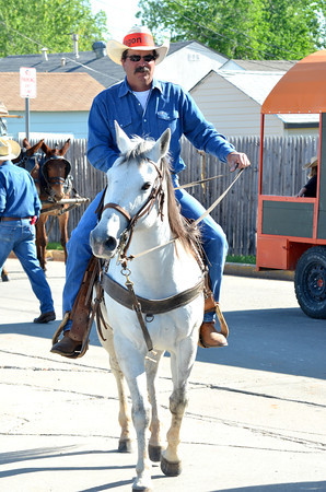 Jeff Mcgee rides guides his horse around before the start of the '89er Day Parade Saturday morning.  The parade featured wagons and other period attire, as well as people in their old-time cars and tractors.<br /> Transcript Photo by Kyle Phillips