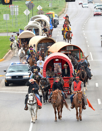 The 89er Day Wagon Train rides into Norman down State Highway 77 Friday afternoon to get ready for the 89er Day festivities that will be going on this weekend.  The Parade will start at Norman High School at 10:00 a.m. and end at Main and Crawford by noon.