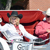 Parade Marshall Dr. Bill Nations, right, and his wife Teena wave at the crowds as they ride down Main Street  in the '89er Day Parade Saturday morning.<br /> Transcript Photo by Kyle Phillips