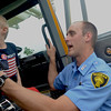 Norman firefighter Justin Patterson shows a young boy the inside of a Norman fire truck Saturday morning at the 8th annual Touch a Truck event at the Cleveland County Fairgrounds.<br /> Transcript Photo by Kyle phillips
