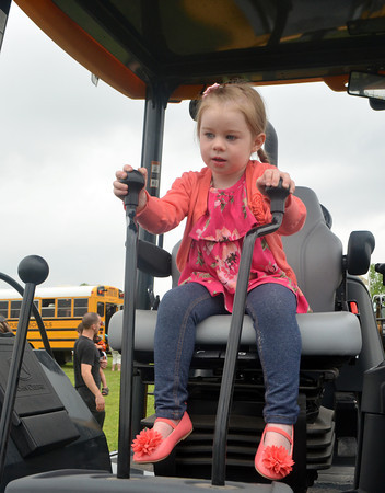Ava Dyer plays with the controls on a construction vehicle saturday mornign at the 8th annual Touch a Truck event at the Cleveland County Fairgrounds.<br /> Transcript photo by Kyle Phillips