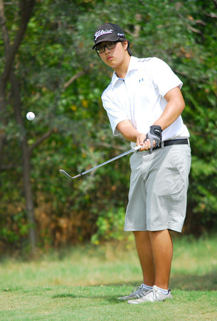 Tyler Tsay watches his ball as he chips it onto the green on the 12th hole Tuesday afternoon during the Sooner Junior All-Stars golf tournament at the Jimmie Austin OU Golf Club.  To see more photos from the tournament visit our photo page at: photos.normantranscript.com/Eventphotos.<br /> Kyle Phillips/The Transcript