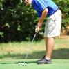 Cooper Bryant watches his ball as he putts on the 12th hole Wednesday afternoon during the Sooner Junior All-Stars Golf Tournament at Jimmie Austin OU Golf Club.<br /> Kyle Phillips/The Transcript