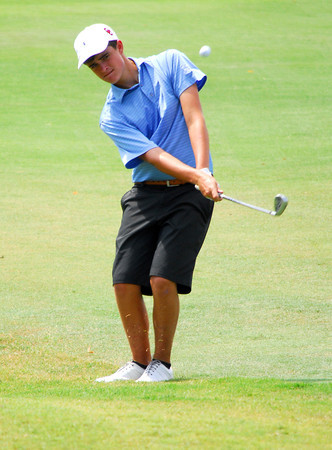 Maxwell Linden chips his ball onto 9th green Tuesday afternoon during the Sooner Junior All-Stars golf tournament at the Jimmie Austin OU Golf Club.  To see more photos from the tournament visit our photo page at: photos.normantranscript.com/Eventphotos.<br /> Kyle Phillips/The Transcript
