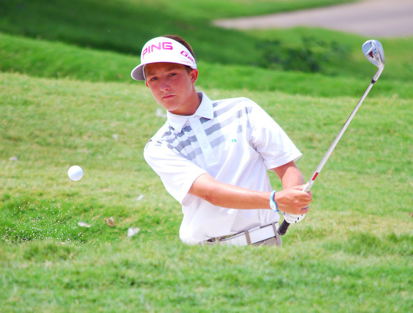 Hunter Austin watches his ball as he chips it onto the green on the 12th hole Tuesday afternoon during the Sooner Junior All-Stars golf tournament at the Jimmie Austin OU Golf Club.  To see more photos from the tournament visit our photo page at: photos.normantranscript.com/Eventphotos.<br /> Kyle Phillips/The Transcript
