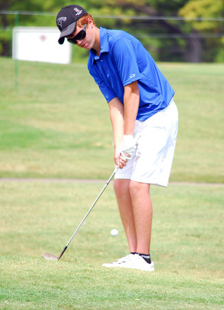 Collin Janawsky chips his ball onto the green on the 9th hole Tuesday afternoon during the Sooner Junior All-Stars golf tournament at the Jimmie Austin OU Golf Club.  To see more photos from the tournament visit our photo page at: photos.normantranscript.com/Eventphotos.<br /> Kyle Phillips/The Transcript