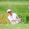 Brandon Rebelez tries to get his bal out of a sand trap  on the 12th hole Wednesday afternoon during the Sooner Junior All-Stars Golf Tournament at Jimmie Austin OU Golf Club.<br /> Kyle Phillips/The Transcript