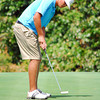 Sam Sicard  watches his ball as he putts on the 12th hole Wednesday afternoon during the Sooner Junior All-Stars Golf Tournament at Jimmie Austin OU Golf Club.<br /> Kyle Phillips/The Transcript