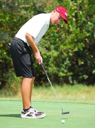 Conner Mears watches his ball as he putts on the 12th hole Wednesday afternoon during the Sooner Junior All-Stars Golf Tournament at Jimmie Austin OU Golf Club.<br /> Kyle Phillips/The Transcript