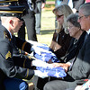 The family of Army Maj. James Lafayette Whited is presented American Flags in honor of the service Whited gave to his country during the Vietnam War.<br /> Kyle Phillips/The Transcript