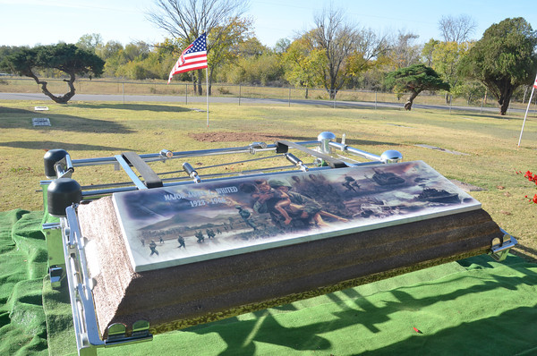 A mural was placed on the lid of Army Maj. James Lafayette Whited's casket to honor him for his service in the Vietnam War.<br /> Kyle Phillips/The Transcript