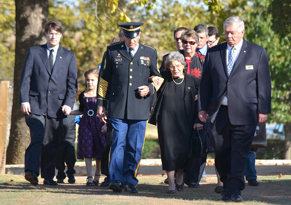 The family of Army Maj. James Lafayette Whited is lead to a memorial servive for Whited Friday at Sunset Memorial Park.<br /> Kyle Phillips/The Transcript
