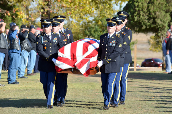The remains of Army Maj. James Lafayette Whited are carried into Sunset Memorial Park Friday as Whited is is honored at his funeral with full military honors after coming home after 46 years.<br /> Kyle Phillips/The Transcript