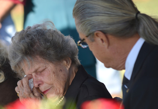 James Whited, left, comforts his mother, Annie, at the funeral of father and husband at Army Maj. James Lafayette Whited's funeral at Suset Memorial Friday morning.<br /> Kyle Phillips/The Transcript
