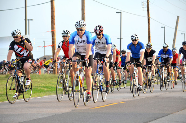 Riders take off from the starting line at the Baptist Children's Home's annual Bike Ride Saturday morning.  The event is held to help raise money for the Oklahoma Baptist Homes for Children. Riders were able to choose between riding  56, 44, 27 or 10.5 mile routes.<br /> Kyle Phillips/The Transcript