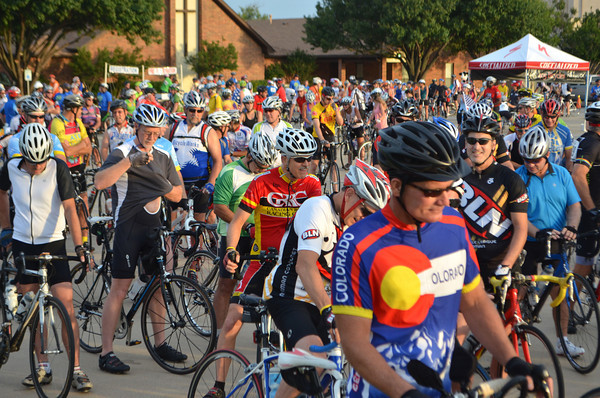 Hundreds of bike riders line up ready to begin the Baptist Children's Home's annual Bike Ride Saturday morning.  The event is held to help raise money for the Oklahoma Baptist Homes for Children. Riders were able to choose between riding  56, 44, 27 or 10.5 mile routes.<br /> Kyle Phillips/The Transcript