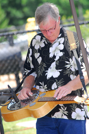 Kenny Davis plays the resonator guitar during a performance by Mountian Smoke Saturday afternoon at the 2nd Annual Battle of the Burger at Marc Heitz Chevrolet.<br /> Kyle Phillips/The Transcript