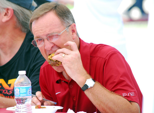 """OU Men's Basketball Coach and celebrity judge Lon Kriger taste tests a burger Saturday afternoon at the 2nd Annual Battle of the Burger at Marc Heitz Chevrolet.  To see more photos from the event visit <a href=""""http://photos.normantranscript.com"""">http://photos.normantranscript.com</a>.<br /> Kyle Phillips/The Transcript"""