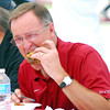"OU Men's Basketball Coach and celebrity judge Lon Kriger taste tests a burger Saturday afternoon at the 2nd Annual Battle of the Burger at Marc Heitz Chevrolet.  To see more photos from the event visit <a href=""http://photos.normantranscript.com"">http://photos.normantranscript.com</a>.<br /> Kyle Phillips/The Transcript"