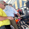 Gary Cavins mans the grill as his team prepares to hand out samples  Saturday at the 2nd Annual Battle of the Burger at Marc Heitz Chevrolet.<br /> Kyle Phillips/The Transcript