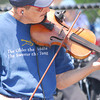 Jimmy Gyles plays the fiddle during a performance by Mountian Smoke Saturday afternoon at the 2nd Annual Battle of the Burger at Marc Heitz Chevrolet.<br /> Kyle Phillips/The Transcript