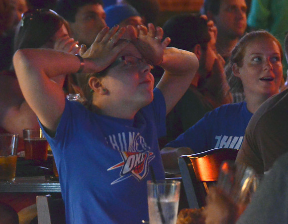 Catherine Temple reacts to a call against the Thunder as she watches game two of the NBA Finals at the Brewhouse Thursday evening.<br /> Kyle Phillips/The Transcript
