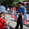 Will and Andrew Bradley, sons of Hank and Aimee Bradley, visit with Sgt. Eric Means of the Norman Brookhaven Fire Station during the Brookhaven Fourth of July festivities on Wednesday. Julie Bragg/ The Transcript