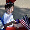 Holly Standridge, age 6, daughter of Lisa and Robert Standridge of Norman, waves her flag from her decorative wagon Wednesday during the Brookhaven Fourth of July festivities. Julie Bragg/ The Transcript