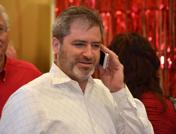 Rob Standridge talks on his phone getting poll results at his election watch party Tuesday.  Standridge won the race for State Senator District 15 against opponent Claudia Griffith.<br /> Kyle Phillips/The Transcript